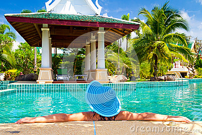 Woman in hat relaxing in oriental resort
