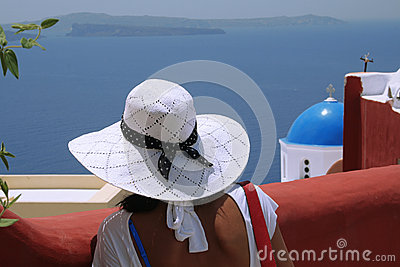 Woman with hat in  Santorini