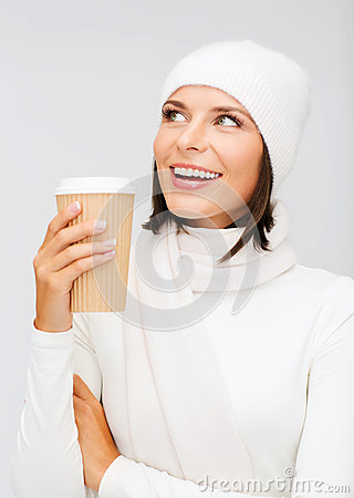 Woman in hat with takeaway tea or coffee cup