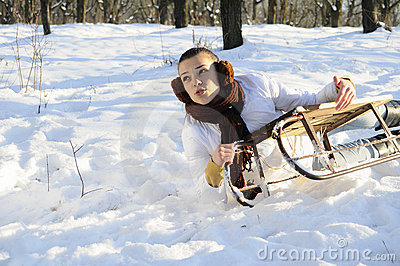 Woman having accident on sledge