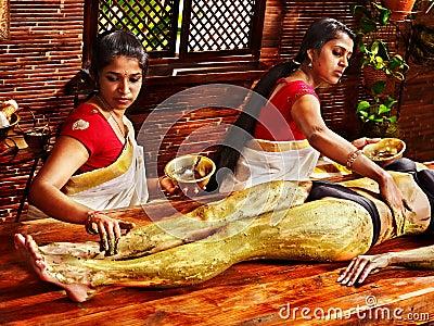 Woman having Ayurvedic feet spa massage.