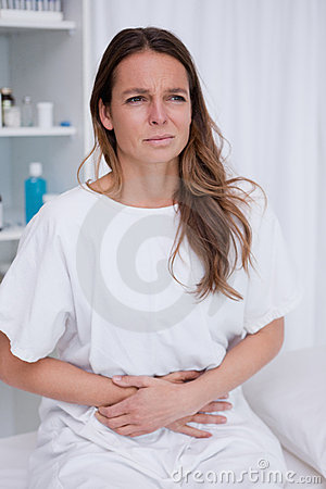 Woman having belly ache