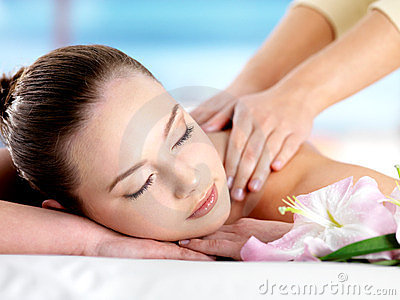 Woman having body massage