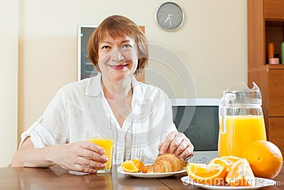 Woman having breakfast with juice