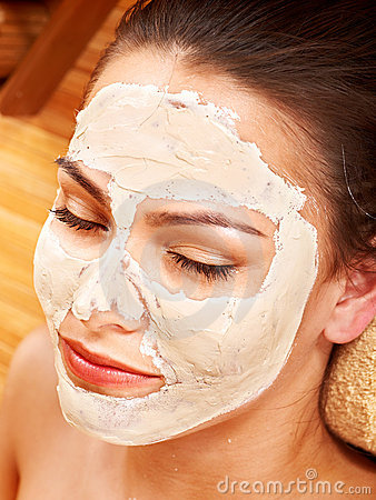 Woman  having clay facial mask.