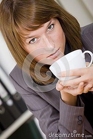 Woman having coffee break at office