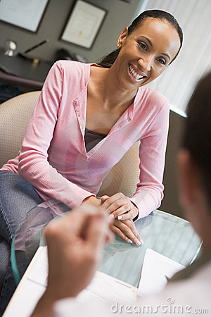 Woman having consultation with doctor in IVF clini