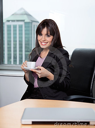 Woman Having Cup Of Coffee