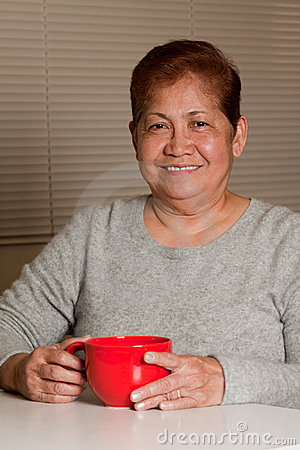 Woman having a cup of coffee at home