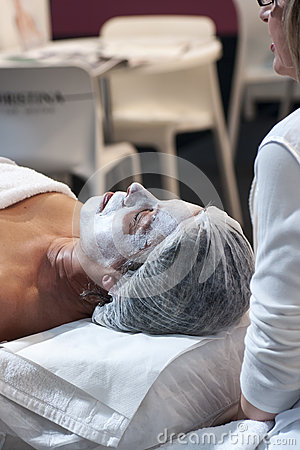 WOMAN HAVING A FACIAL COSMETIC MASK Editorial Image