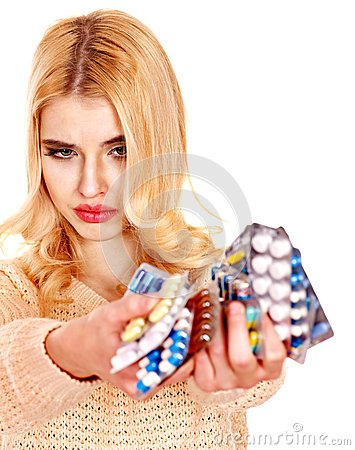 Woman having flu takes pills.