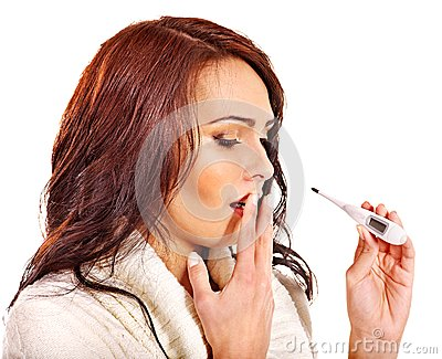 Woman having  flue  taking thermometer.