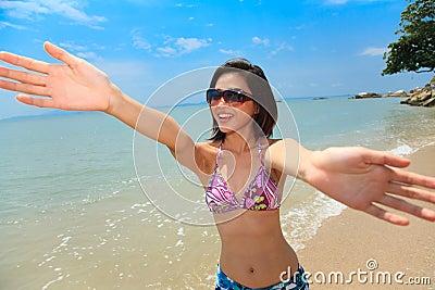 Woman having fun at the beach