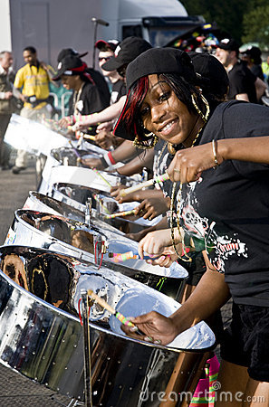 A woman having fun and playing steel drums Editorial Stock Image