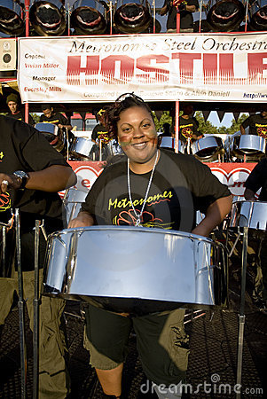 A woman having fun and playing steel drums Editorial Photography