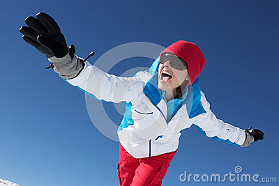 Woman Having Fun On Ski Holiday In Mountains