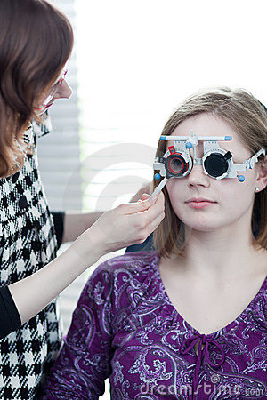 Woman having her eyes examined by an eye doctor