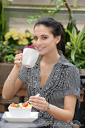 Woman having lunch in outdoor cafe