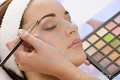 Woman Having Make Up Applied by Beautician at Spa