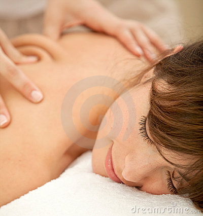 Woman having a massage on her back