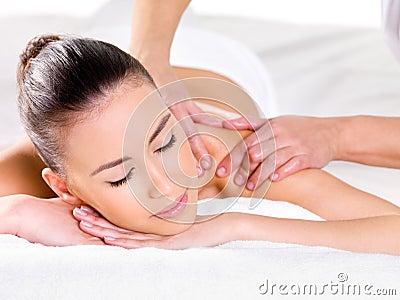 Woman having massage on shoulder