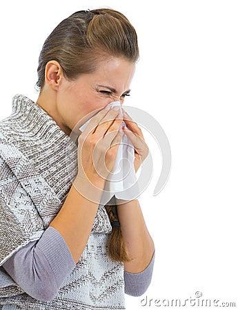 Woman having running nose and using napkin