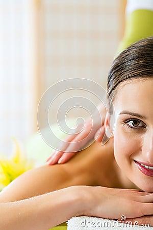 Woman having a wellness back massage