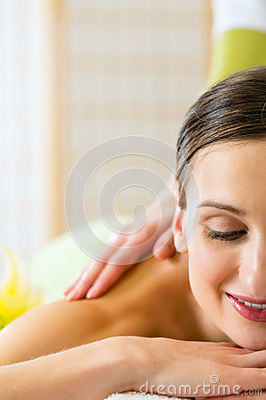 Woman having a wellness back massage