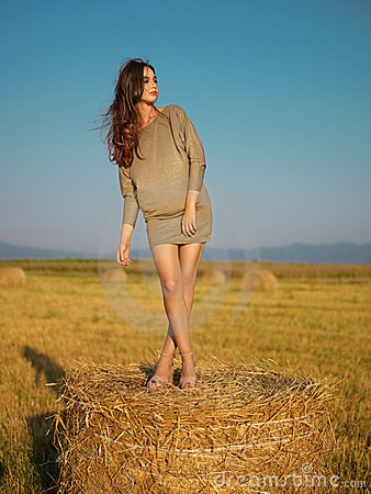 Woman on hay bale