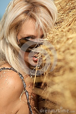 Woman  in hay stack