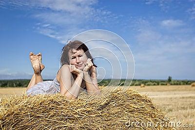 Woman on haystack