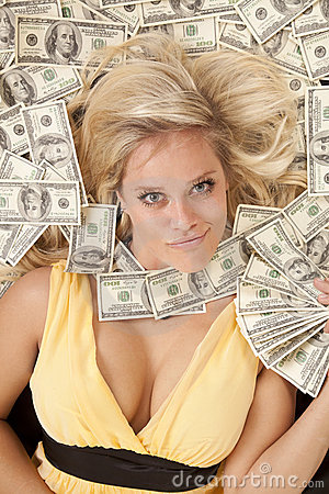Woman head in money with money fan