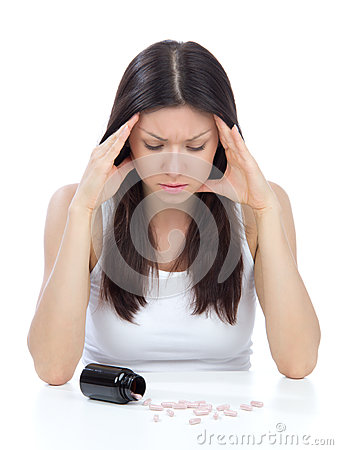 Woman with headache look on pills medicine tablets