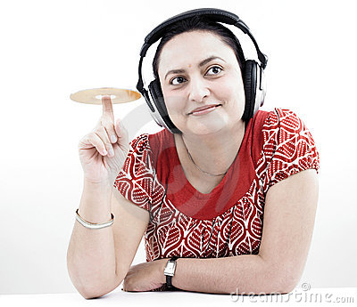 Woman with headphones and cd