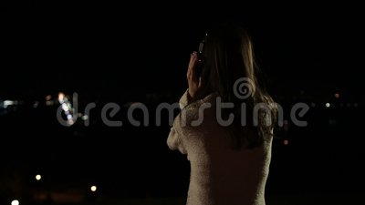 Woman with headphones listening music at night stock video