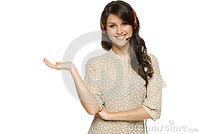 Woman in headset holding empty copy space on her open palm