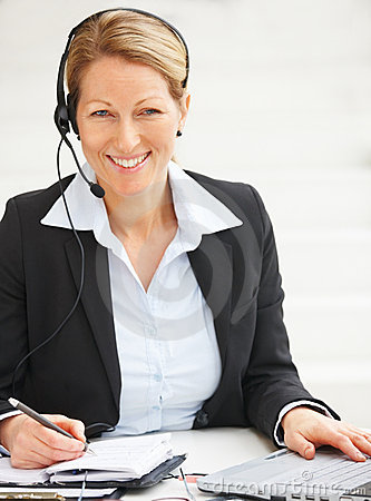 Woman with headset in office