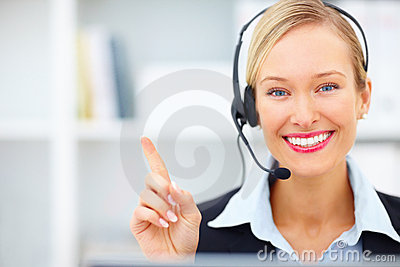 Woman with  headset pointing towards copyspace