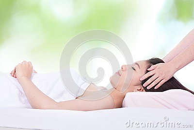 Woman in health spa with green background