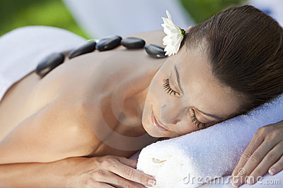 Woman At Health Spa Having Hot Stone Massage