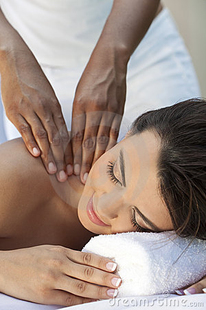 Woman At Health Spa Having Relaxing Massage