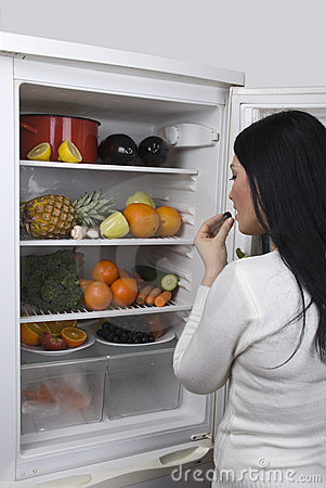 Woman with healthy food in fridge