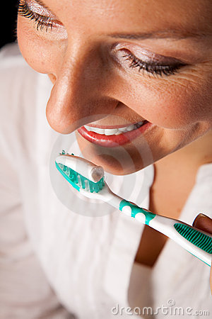 Woman healthy teeth closeup on black