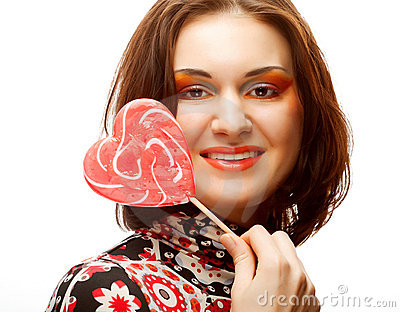 Woman with heart lolly pop