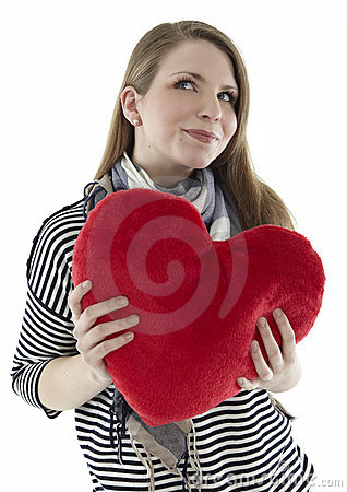 Woman with a heart pillow