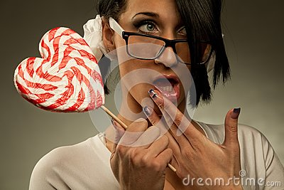 Woman with heart shaped lollipop