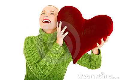 Woman with heart-shaped pillow