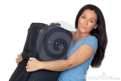 Woman with a heavy suitcase
