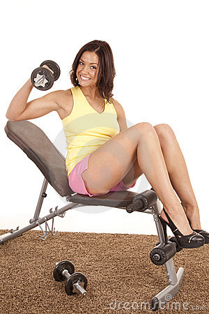 Woman in heels on weight bench