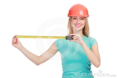 Woman in a helmet with tape measure